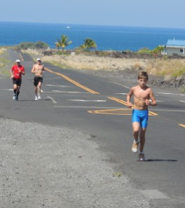 Doing a Long Run in Kona (Energy Lab) with Kyle Buckingham 2012. Young Jamie in the foreground doing his 'long' run!